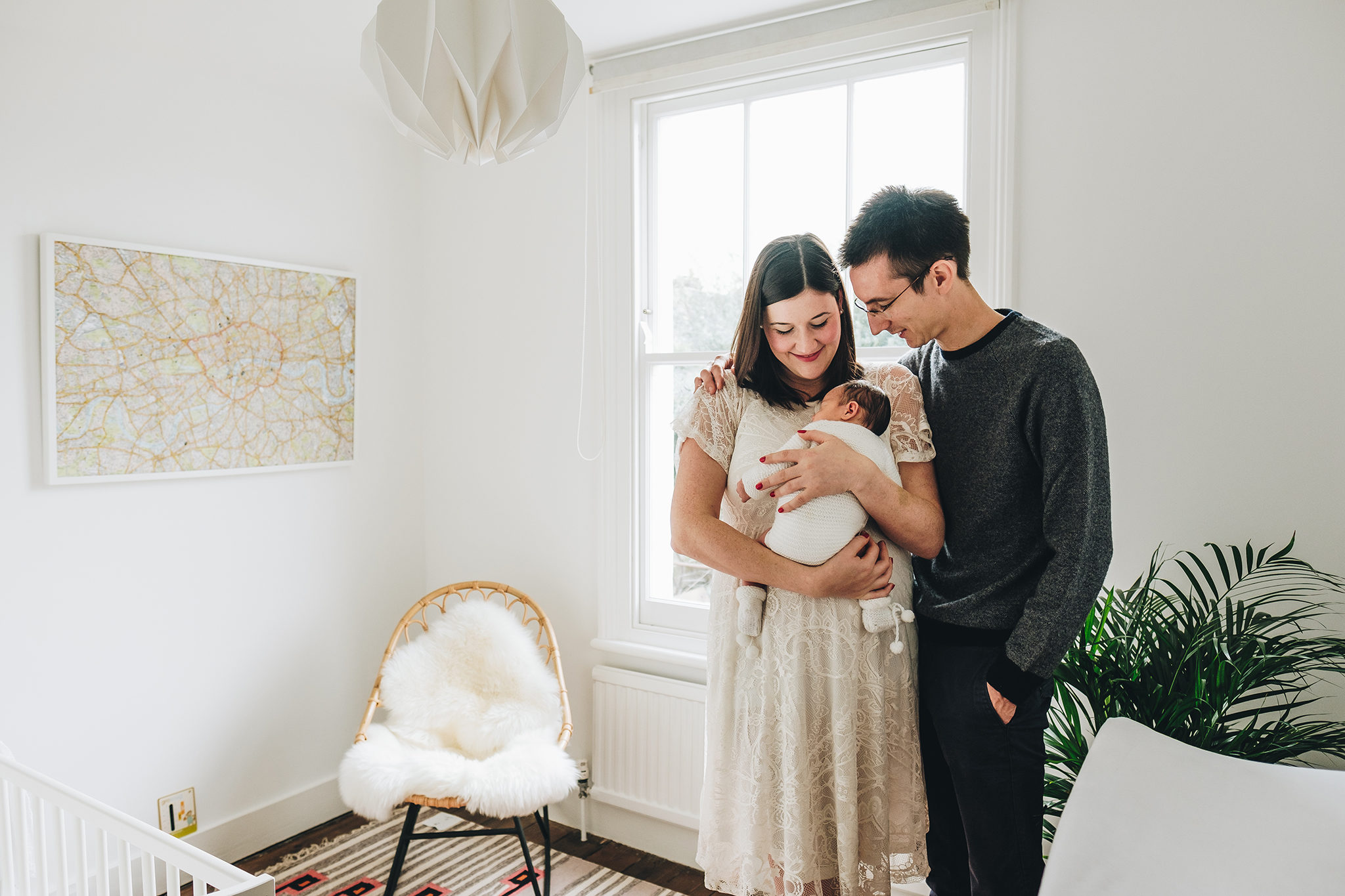Couple with newborn baby in their London home by photographer Elle Narbrook